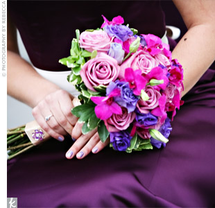 The bridesmaids carried an assortment of lavender roses, purple lisianthus and purple dendrobium orchids. The lighter purples complemented the dark, plum-colored dresses.