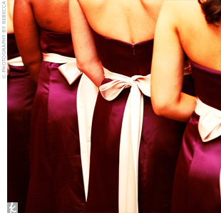The four bridesmaids wore full-length plum-colored gowns with champagne sashes and matching shoes. The sweetheart necklines matched the bride's gown.