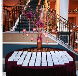The cards were displayed on a table decorated with gold branches strung with beaded candles and clusters of plum blooms and crystals.