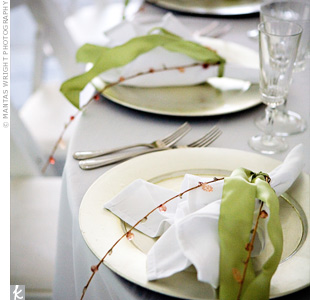 Tables were dressed in ivory table linens and pewter chargers, along with ivory napkins wrapped in handmade, beaded napkin rings.
