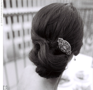 Breck wore her locks back in a low loose bun with a crystal vintage-inspired hairpin. During the ceremony, she donned a Vera Wang cathedral-length veil.