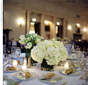 The couple used vases in different sizes to create drama on the tables. Each was filled with a variety of tulips, hydrangeas or roses.