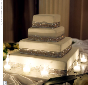 Breck and Rob served a simple four-tiered cake covered in white fondant and filled with lemon. Two bands of rhinestones around each layer matched the bride's dress.
