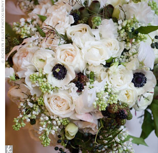 Caroline carried an arrangement of garden roses, ranunculus, lilacs, lemon leaves, eucalyptus pods, un-ripened raspberries and blueberries and anemones with navy blue centers and feathers. It was so heavy the bridesmaids fought over who would hold it!
