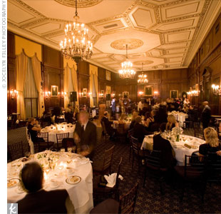 Guests gathered in an old-fashioned gentleman's club to celebrate. The dining and cocktail areas, dance floor, and even the dessert table were all located in different rooms.