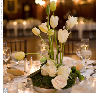 Each table was topped with a different cluster of flowers. The arrangements varied in height and included everything from roses to tall wispy tulips.