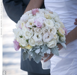 When Kim found her dream bouquet in a magazine, she hired the same florist to re-create it for her. The arrangement was filled with pink and cream roses and wrapped with a white ribbon.