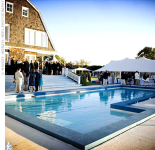 Following the ceremony, guests mingled around the pool area and porch while enjoying aqua blue martinis and a clam bar with oysters, shrimp, and clams.