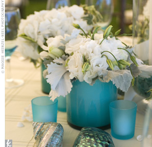 Metallic seashells were strewn around the centerpieces to add a waterside element to the recetpion tables.