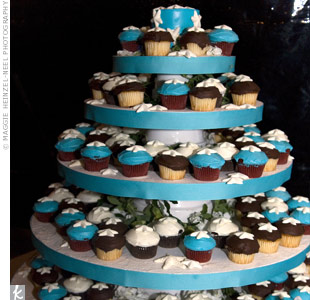 To fit with their color palette and theme, the couple decided to serve red velvet cupcakes covered with white, chocolate, and aqua frosting and topped with a starfish-shaped candy.
