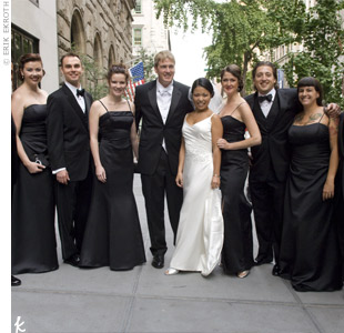 Kim's three bridesmaids wore black satin dresses by Alfred Angelo, while the groomsmen wore black tuxes.