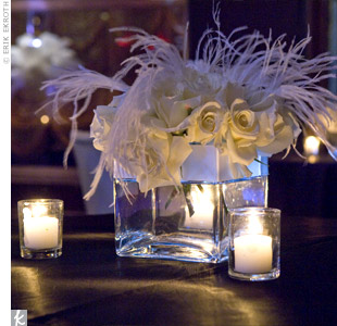 The smaller reception tables were accented with white roses and feathers.
