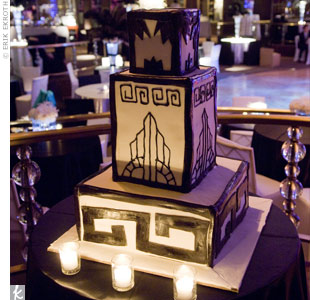 The unique three-tiered cake was decorated in black-and-white frosting and covered with Art Deco designs.