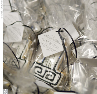 At the end of the evening guests took home cookies resembling the couple's Art Deco wedding cake. The goodies were wrapped in bags and tied off with a black satin ribbon with favor tags imprinted with the couple's logo.