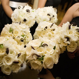 For a black-and-white Manhattan wedding, Shawn gave traditional roses and ranunculus a modern edge by scattering spiraling fiddlehead ferns throughout each bouquet. They had all the romance of conventional bouquets, but also felt fresh and hip.