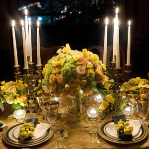 Old-world glamour and summer romance collided at this Great Gatsby-worthy wedding. Striking candelabra matched the extravagance of the overstuffed yellow-and-green centerpieces.
