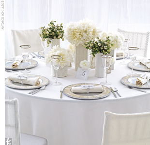 Cloud + Cream + PlatinumCuddle up with a cozy wrapped-in-cable-knit theme. Mosaic Shell aluminum chargers, platinum rim glassware, Lexington flatware, ivory linens, and silver reception chairs from Party Rental Ltd. 