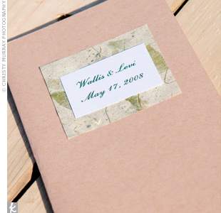 Natural-colored programs were layered with textured leaf print paper and a white card with the couple's names and wedding date.