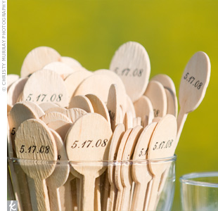 Wooden stirrers with the couple's wedding date dressed up each cocktail.