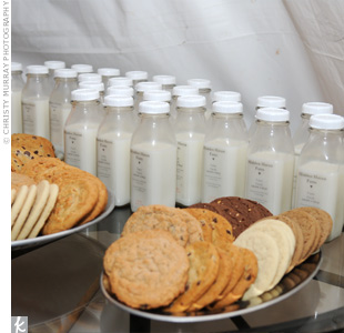 Guests snacked on assorted cookies from a local bakery and individual bottles of milk. The couple added labels to the milk to make it look like it came from the groom's family farm.