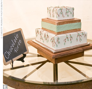 The couple's cake, a three-tiered brown and sage chocolate torte, sat on a homemade table created from an Amish wagon wheel.