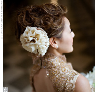 For the reception, Mimi slipped into a golden-hued couture Chinese dress with intricate beading and Chantilly lace flown in from France.