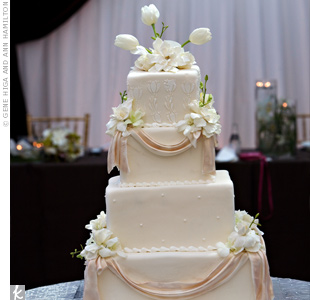 Ivory fondant, a simple design, and fresh flowers accented the elegant four-tiered cake.