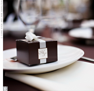 Friends and family pitched in to create the favors—chocolate brown boxes filled with vanilla sugar cookies decorated with the couple's monogram.