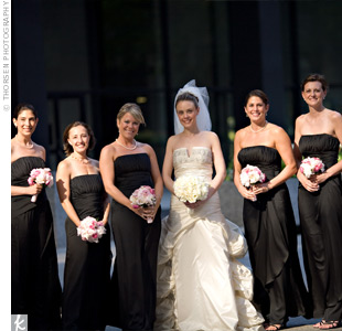 The bridesmaid's pink and white bouquets popped against their black, strapless, floor-length gowns.