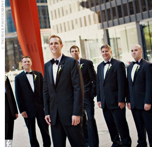 The groomsmen were stylish in classic black two-button tuxes with black bow ties and cummerbunds.