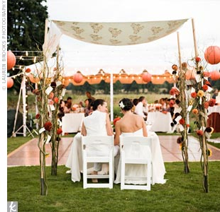 Christina and Kathleen rented three large tents and arranged them into a U-shape with the dance floor in the middle. White twinkle lights were strung around the interior of each tent and over the dance floor, while red and orange paper lanterns in varying sizes hung from the lights on the perimeter of the dance floor.