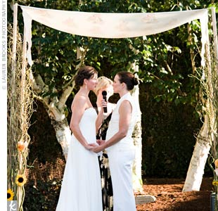Kathleen and Christina exchanged vows that they wrote themselves. After the vows, a guitarist played while guests added a dahlia to one of the poles of the huppah.