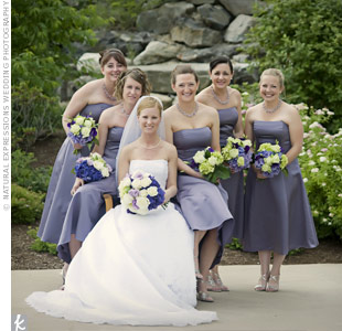 Kim&#39;s five bridesmaids wore lilac, strapless, tea-length dresses. A rhinestone belt added a bit of flair to the look and complemented the wedding&#39;s silver accents.