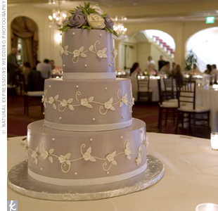 Kim and Chris chose a gorgeous three-tiered lavender cake. It was covered in lavender fondant and decorated with white scrolling vines and flowers reminiscent of the motif on their programs.