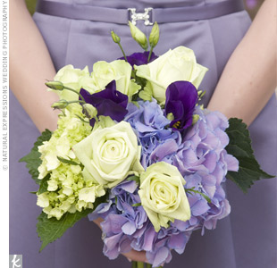 The bridesmaid bouquets were smaller replicas of the bridal bouquet and consisted of lavender and purple lisianthus and hydrangeas, and white roses and hydrangeas.