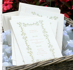 To convey their wedding's traditional theme, the couple chose a scrolling green vine motif for the cream-colored programs.