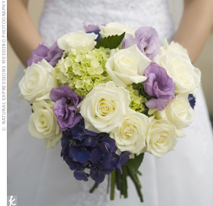 Lavender lisianthus and purple hydrangeas popped against the green hydrangeas and white roses in Kim&#39;s bouquet.