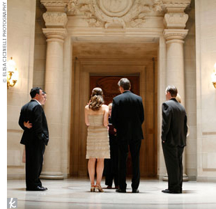 """After they signed the marriage license, they walked up the grand staircase to the city hall rotunda to meet with their officiant. """"We were very lucky that the rotunda at the top of the staircase was available for the ceremony,"""" Melanie says."""