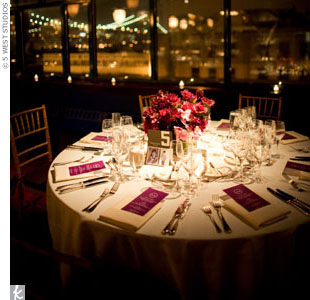 The Brooklyn Bridge backdrop and magenta blooms accented with votive candles created a romantic ambience.