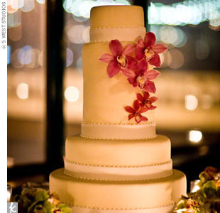 Varying-sized tiers and a sprinkling of magenta cymbidium orchids gave the cake contemporary appeal.