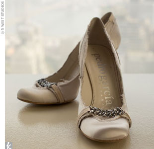 Determined to find the right wedding shoes, Danielle carried a fabric swatch from her dress in her purse at all times. After months of searching, she finally spotted this perfect pair, which was embellished with crystals.