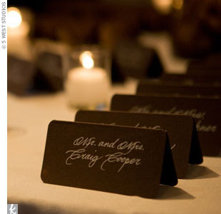 The couple went the modern route with dark escort cards, which had elegant, light-colored calligraphy.