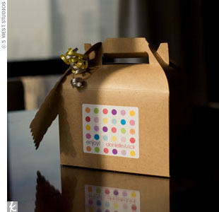 Boxes filled with the couple's favorite treats and information about the weekend's events waited for out-of-town guests in their hotel rooms. A polka-dotted sticker personalized the containers.
