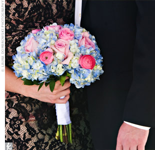 "As her ""something blue,"" Melissa's mom gave her a bouquet of blue hydrangeas with pink rose and ranunculus accents for the day."