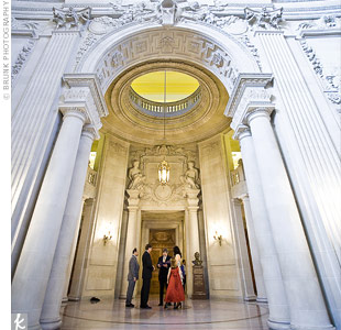 "The couple chose to wed in San Francisco specifically because of its city hall. Leslie's dad and daughter stood in as witnesses. ""I love the inscription in the marble above the officiant,"" says Leslie."
