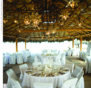 Guests sat at alternating long and round tables under the palapa. Crisp white linens and Mexican star-shaped lights added to the ambience.