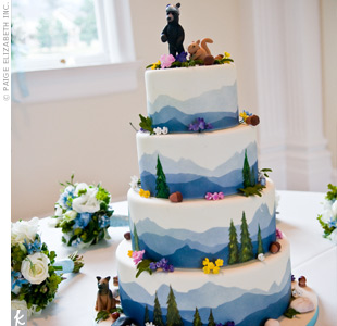 Friends of the couple brought the cake all the way from Baltimore! This four-tiered confection featured a blue mountainscape with pine trees and acorns accented with pink, yellow, and purple fondant flowers. For an extra personal touch, a model of their dog, Rocco, made out of fondant sat at the base of the cake.