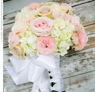 Desiree carried a bouquet of Sahara roses, white hydrangeas, Cinderella garden roses, pink spray roses, and oceana roses.