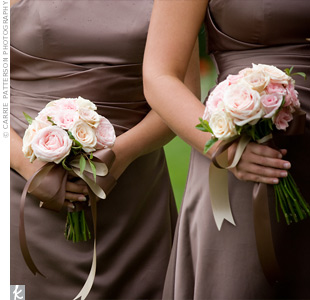 The bridesmaids wore mocha dresses by Alfred Angelo, which looked great with their pink bouquets.