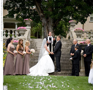 Urns filled with bright pink impatiens accented the steps of the Daly Mansion, and pale pink rose petals lined the ceremony aisle.